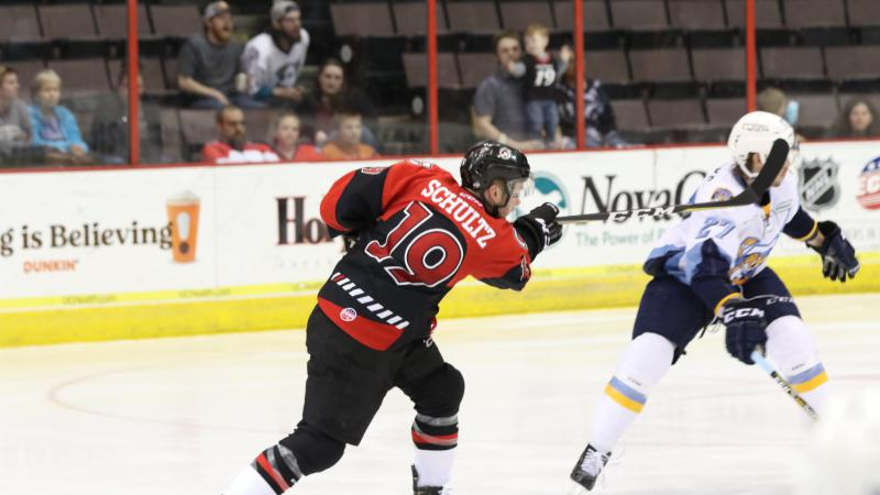 CYCLONES USE BIG SECOND PERIOD TO GET BY TOLEDO