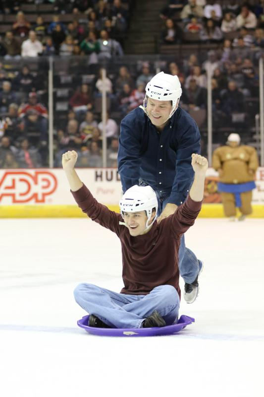 Cyclones fans sliding to victory at intermission.